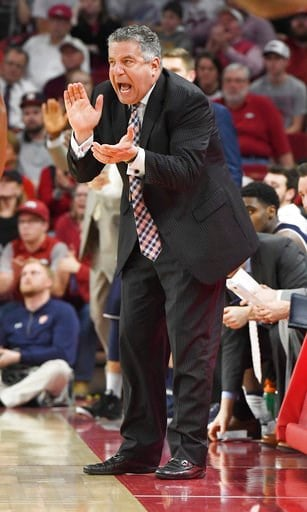 (AP Photo/Michael Woods). Auburn coach Bruce Pearl reacts to a call against Arkansas during the second half of an NCAA college basketball game Tuesday, Feb. 27, 2018, in Fayetteville, Ark.