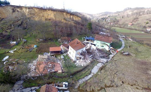(AP Photo). This aerial photo shows buildings damaged by a landslide caused by melting snow in Kostajnica, central Croatia, Tuesday, March 13, 2018.  The incident happened just as Prime Minister Andrej Plenkovic attended an emergency session of the loc...