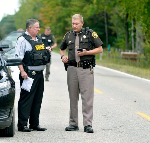 (Lisa Yanick Litwiller /The Morning Sun via AP). In this Sept. 27, 2017 photo, Isabella County Sheriff Michael Main, right, coordinates efforts in a police manhunt to locate a suspect in Michigan. Main is apologizing for accidentally leaving his gun in...