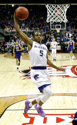 (AP Photo/Charlie Riedel, File). FILE - In this March 8, 2018, file photo, Kansas State's Barry Brown goes to the basket against TCU during the second half of an NCAA college basketball game in the Big 12 men's tournament, in Kansas City, Mo. The succe...