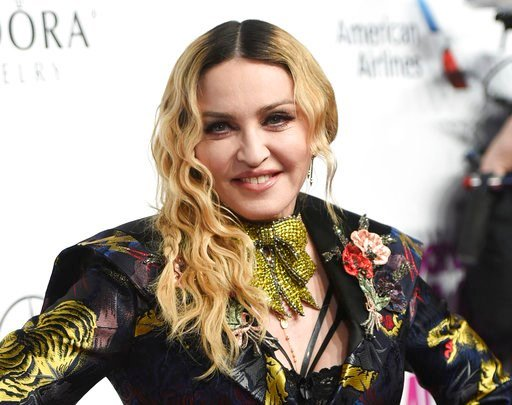 (Photo by Evan Agostini/Invision/AP, File). FILE - In this Dec. 9, 2016 file photo, Madonna attends the 11th Annual Billboard Women in Music honors in New York. MGM Motion Picture Group president Jonathan Glickman says Tuesday that the pop music icon w...