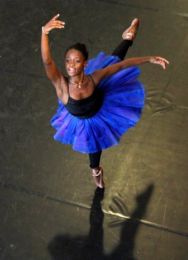 "(AP Photo Denis Farrell, File). FILe - In this July 10, 2012 file photo, dancer Michaela DePrince rehearses for her lead role in Le Corsaire in Johannesburg. Pop Star Madonna will direct a film based on  DePrince's memoir ""Taking Flight: From War Orpha..."