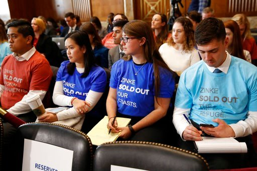 (AP Photo/Jacquelyn Martin). Attendees of a Senate Committee on Energy and Natural Resources committee hearing wear t-shirts protesting Interior Secretary Ryan Zinke, as he testifies before the committee about the President's Budget Request for Fiscal ...