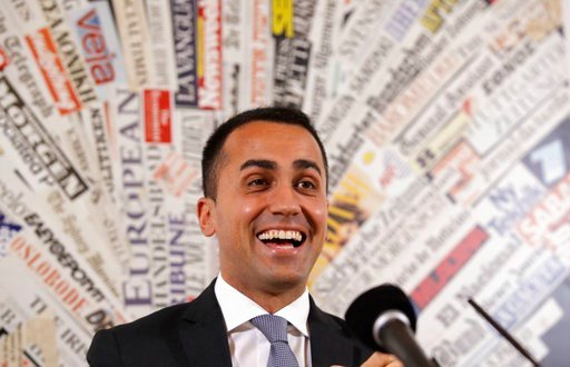 (AP Photo/Alessandra Tarantino). Five-Star Movement's leader Luigi Di Maio smiles during a press conference at the foreign press association headquarters in Rome, Tuesday, March 13, 2018.