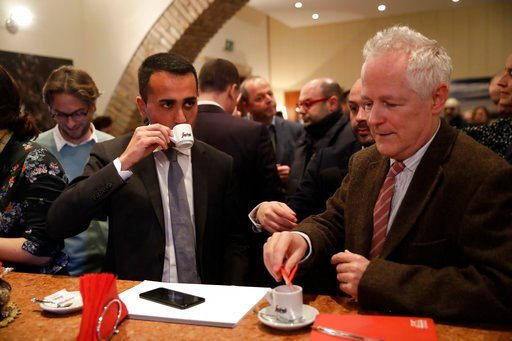 (AP Photo/Alessandra Tarantino). Five-Star Movement's leader Luigi Di Maio, left, drinks a coffee with Philip Willan, President of foreign press association, in Rome, Tuesday, March 13, 2018.