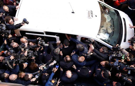 (AP Photo/Alessandra Tarantino). Five-Star Movement's leader Luigi Di Maio, center, back to the camera, is mobbed by reporters as he boards a taxi as he leaves the foreign press association headquarters in Rome, Tuesday, March 13, 2018. Luigi Di Maio, ...