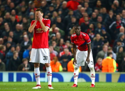 (AP Photo/Dave Thompson). Manchester United's Nemanja Matic reacts after Sevilla scored their second goal of the game as he waits for the restart during the Champions League round of 16 second leg soccer match between Manchester United and Sevilla, at ...