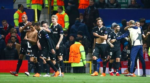 (AP Photo/Dave Thompson). Sevilla's Wissam Ben Yedder, second left puts his shirt back on as he celebrates with teammates after scoring his sides second goal during the Champions League round of 16 second leg soccer match between Manchester United and ...
