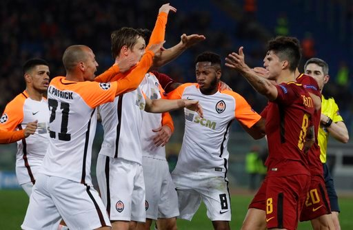 (AP Photo/Gregorio Borgia). Roma and Shakhtar players face each others during a Champions League round of 16 second-leg soccer match between Roma and Shakhtar Donetsk, at the Rome Olympic stadium, Tuesday, March 13, 2018.