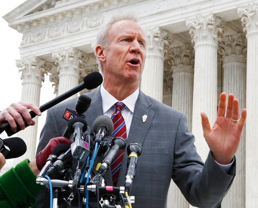(AP Photo/Jacquelyn Martin, File). FILE - In this Monday, Feb. 26, 2017, file photo, Illinois Governor Bruce Rauner speaks to the media outside the Supreme Court, in Washington. Gov. Rauner plans to veto legislation that would require gun retailers to ...