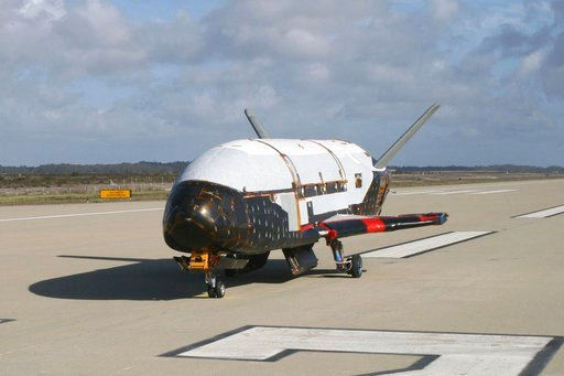 """(U.S. Air Force via AP). This June 2009 photo provided by the U.S. Air Force via NASA shows the X-37B Orbital Test Vehicle at Vandenberg Air Force Base, Calif. President Donald Trump says there may someday be a """"space force"""" fighting alongside the Air ..."""