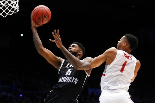 (AP Photo/John Minchillo). LIU Brooklyn's Zach Coleman (5) shoots against Radford's Carlik Jones (1) during the first half of a First Four game of the NCAA men's college basketball tournament, Tuesday, March 13, 2018, in Dayton, Ohio.