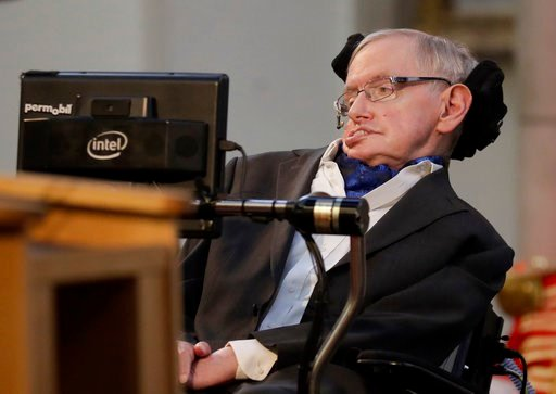 (AP Photo/Matt Dunham, File). FILE - In this March 6, 2017 file photo, Britain's Professor Stephen Hawking delivers a keynote speech as he receives the Honorary Freedom of the City of London during a ceremony at the Guildhall in the City of London. Haw...