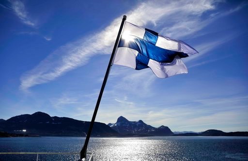 (AP Photo/David Goldman, file). FILE - In this Saturday, July 29, 2017 file photo, Finland's flag flies aboard the Finnish icebreaker MSV Nordica as it arrives into Nuuk, Greenland. Finland has come out on top of an international index that ranks natio...
