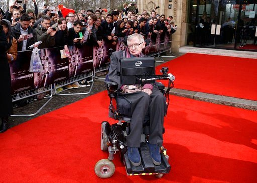 (Photo by Joel Ryan/Invision/AP, File). FILE - In this March 30, 2015 file photo, Professor Stephen Hawking poses for photographers upon arrival for the Interstellar Live show at the Royal Albert Hall in central London. Hawking, whose brilliant mind ra...