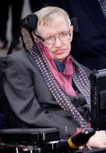 (Photo by Joel Ryan/Invision/AP, File). FILE - In this March 30, 2015 file photo, Professor Stephen Hawking arrives for the Interstellar Live show at the Royal Albert Hall in central London. Hawking, whose brilliant mind ranged across time and space th...