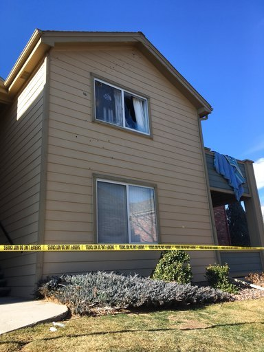 (AP Photo/Colleen Slevin, File). In this Jan. 1, 2018, file photo, Deputy Zack Parrish's a suburban Denver apartment building where he was fatally shot is riddled by bullet holes.