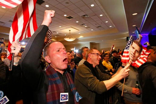(AP Photo/Gene J. Puskar). John Henninger, left, and Eric Larson, right, of Cecil Township, Pa., watches early returns at the election night party of Conor Lamb, the Democratic candidate.