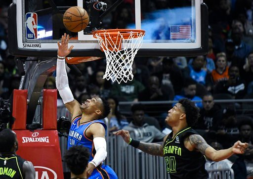 (AP Photo/John Amis). Oklahoma City Thunder guard Russell Westbrook shoots a reverse layup as Atlanta Hawks forward John Collins (20) defends during the first half of an NBA basketball game, Tuesday, March 13, 2018, in Atlanta.