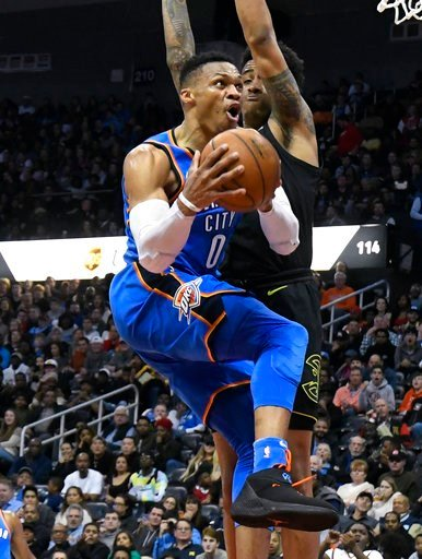 (AP Photo/John Amis). Oklahoma City Thunder guard Russell Westbrook (0) goes to the basket with Atlanta Hawks guard Isaiah Taylor defending during the second half of an NBA basketball game, Tuesday, March 13, 2018, in Atlanta. Oklahoma City won 119-107.