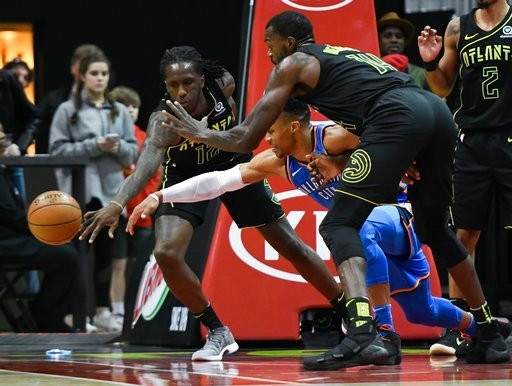 (AP Photo/John Amis). Atlanta Hawks forward Taurean Prince, left, Oklahoma City Thunder guard Russell Westbrook and center Dewayne Dedmon, right, vie for a loose ball during the first half of an NBA basketball game, Tuesday, March 13, 2018, in Atlanta.