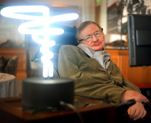 (Anthony Devlin/PA via AP). In this Feb. 25, 2012 photo, Professor Stephen Hawking poses beside a lamp titled 'black hole light' by inventor Mark Champkins, presented to him during his visit to the Science Museum in London. Hawking, whose brilliant min...