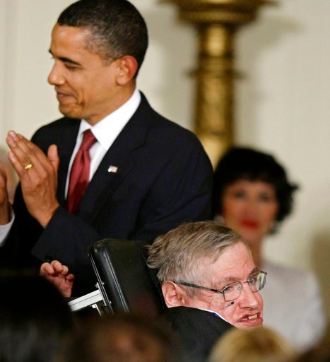 (AP Photo/J. Scott Applewhite, File). FILE - In this Wednesday, Aug. 12, 2009 file photo President Barack Obama applauds after presenting the 2009 Presidential Medal of Freedom to Stephen Hawking, the renown theoretical physicist and Cambridge Universi...