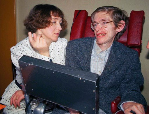 (AP Photo/Lionel Cironneau, File). FILE - In this March 3, 1989 file photo British astrophysicist Dr. Stephen Hawking, 47, answers newsmen with the help of his computer and the assistance of his then wife Jane, in Paris. Hawking, who has a motor neuron...