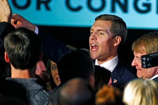 (AP Photo/Gene J. Puskar). Conor Lamb, the Democratic candidate for the March 13 special election in Pennsylvania's 18th Congressional District, center, celebrates with his supporters at his election night party in Canonsburg, Pa., early Wednesday, Mar...