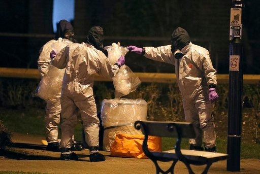 (Andrew Matthews/PA via AP). Investigators in protective suits work at the scene in the Maltings shopping centre in Salisbury, England, Tuesday, March 13, 2018. The use of Russian-developed nerve agent Novichok to poison ex-spy Sergei Skripal and his d...