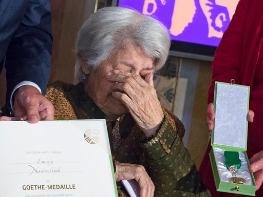 (AP Photo/Jens Meyer, File). FILE - In this Aug. 28, 2017 file photo, Goethe medal award winner Lebanese writer Emily Nasrallah cries during the 2017 Goethe Medals awards presentation in the Grand Ducal Palace in Weimar, Germany. Lebanese writer and fe...