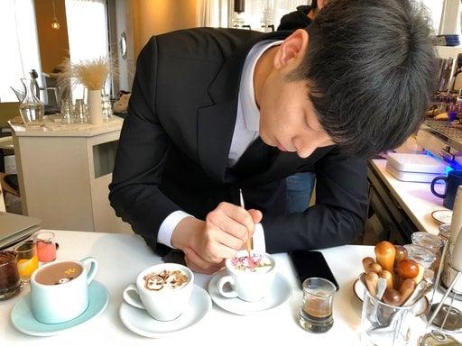Mocha master: SKorea barista adorns coffee with works of art - | WBTV Charlotte