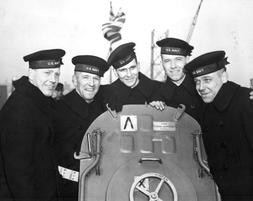(U.S. National Archives via AP). This Feb. 14, 1942 photo provided by the U.S. National Archives shows the five Sullivan brothers on board USS Juneau (CL-52) at the time of her commissioning ceremonies at the New York Navy Yard. The brothers who were a...