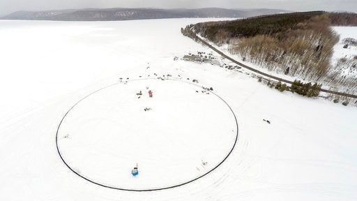 (AP Photo/Paul Cyr). This photo provided by Paul Cyr shows a massive ice carousel that's 427 feet in diameter on Saturday, April 7, 2018, on a frozen lake in Sinclair, Maine. Volunteers say it's large enough to beat the old record held by a town in Fin...