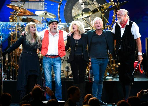 (Photo by Evan Agostini/Invision/AP, File). FILe - In this Jan. 26, 2018 file photo, Fleetwood Mac band members, from left, Stevie Nicks, John McVie, Christine McVie, Lindsey Buckingham and Mick Fleetwood appear at the 2018 MusiCares Person of the Year...