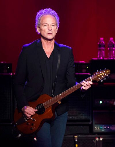 (Photo by Charles Sykes/Invision/AP, FIle). FILE - In this Oct. 6, 2014 file photo, Lindsey Buckingham from the band Fleetwood Mac performs at Madison Square Garden in New York. The band said in a statement Monday that Buckingham is out of the band for...