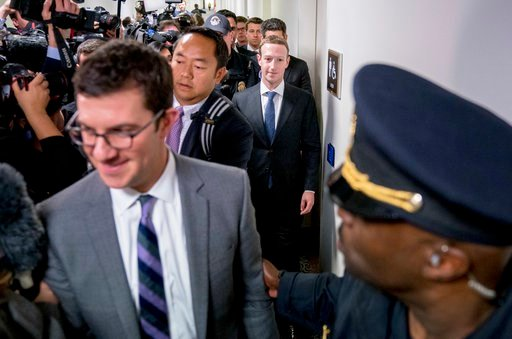 (AP Photo/Andrew Harnik). Facebook CEO Mark Zuckerberg leaves a meeting on Capitol Hill in Washington, Monday, April 9, 2018.