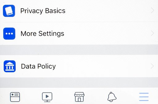 "(AP Photo/Mark Lennihan). Tabs on a Facebook app for, ""Privacy Basics, More Settings, and Data Policy,"" are displayed on an iPhone, Monday, April 9, 2018, in New York."