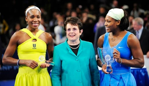 (AP Photo/Stephen Chernin, File). FILE - In this March 2, 2009, file photo, Billie Jean King is flanked by Venus, left, and Serena Williams after Serena defeated Venus in the championship match of the Billie Jean King Cup tennis exhibition, at Madison ...