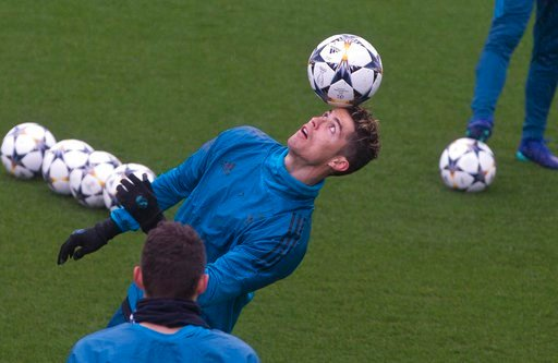 Real Madrid's Cristiano Ronaldo controls the ball during a training session in Madrid, Tuesday, April 10, 2018. Real Madrid will play Juventus Wednesday in a Champions League quarter-final, 2nd leg soccer match.(AP Photo/Paul White