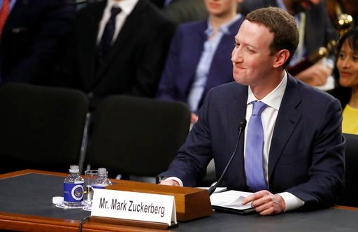 (AP Photo/Alex Brandon). Facebook CEO Mark Zuckerberg reacts to a question about the hotel he stayed in last night as he testifies before a joint hearing of the Commerce and Judiciary Committees on Capitol Hill in Washington, Tuesday, April 10, 2018, a...