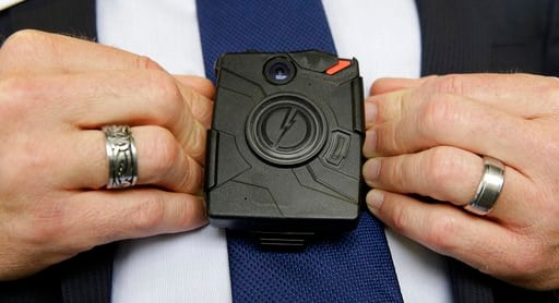 (AP Photo/Rich Pedroncelli,File). In this Feb. 19, 2015, file photo, Steve Tuttle, vice president of communications for Taser International, demonstrates one of the company's body cameras during a company-sponsored conference.