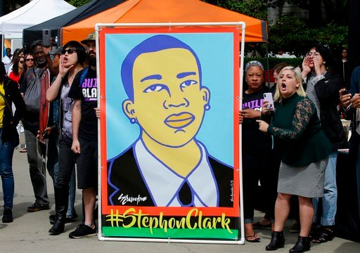 (AP Photo/Rich Pedroncelli,File). In this April 9, 2018, file photo, protesters display an image of Stephon Clark at a crime victims rights rally, at the Capitol in Sacramento, Calif.