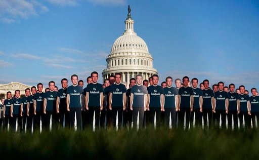 "(AP Photo/Carolyn Kaster). Life-sized cutouts depicting Facebook CEO Mark Zuckerberg wearing ""Fix Fakebook"" T-shirts are displayed by advocacy group, Avaaz, on the South East Lawn of the Capitol on Capitol Hill in Washington, Tuesday, April 10, 2018, a..."