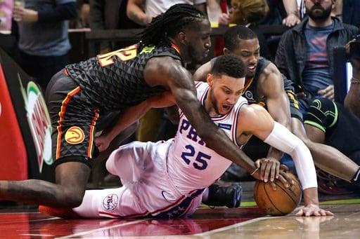 (AP Photo/John Amis). Philadelphia 76ers guard Ben Simmons (25) Atlanta Hawks forward Taurean Prince left, and guard Isaiah Taylor vie for a loose ball during the first half of an NBA basketball game Tuesday, April 10, 2018, in Atlanta.