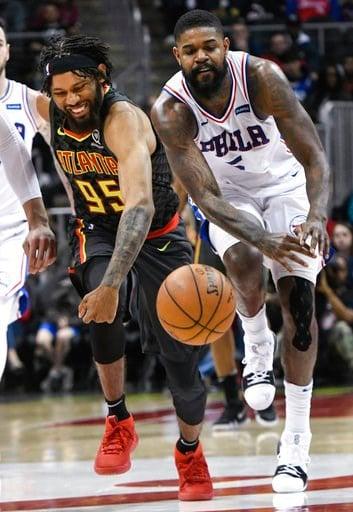 (AP Photo/John Amis). Atlanta Hawks forward DeAndre' Bembry (95) and Philadelphia 76ers center Amir Johnson (5) chase a loose ball during the second half of an NBA basketball game Tuesday, April 10, 2018, in Atlanta. Philadelphia won 121-113.