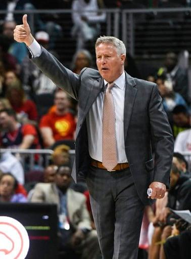 (AP Photo/John Amis). Philadelphia 76ers coach Brett Brown signals players during the second half of an NBA basketball game against the Atlanta Hawks Tuesday, April 10, 2018, in Atlanta. Philadelphia won 121-113.