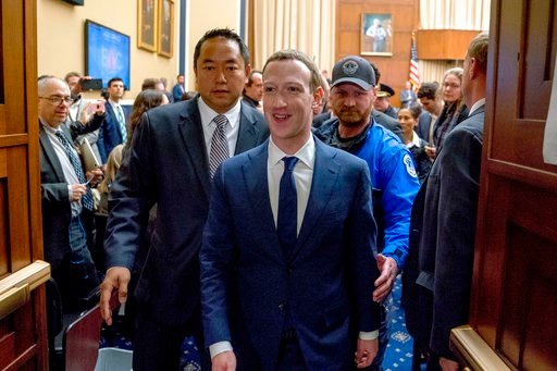 (AP Photo/Andrew Harnik). Facebook CEO Mark Zuckerberg smiles as he departs after testifying before a House Energy and Commerce hearing on Capitol Hill in Washington April 11 about the use of Facebook data to target American voters.