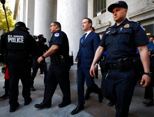 (AP Photo/Jacquelyn Martin). Facebook CEO Mark Zuckerberg leaves the Rayburn House Office Building after testifying before a House Energy and Commerce hearing on Capitol Hill in Washington.