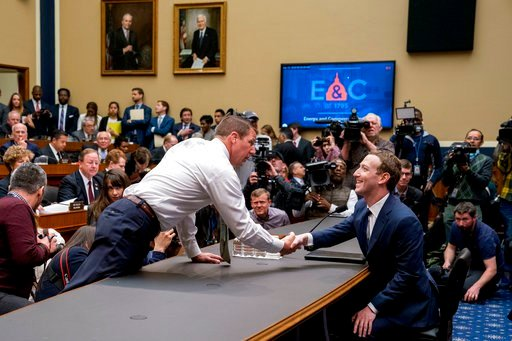 (AP Photo/Andrew Harnik). Rep. Markwayne Mullin, R-Okla., left, greets Facebook CEO Mark Zuckerberg, right, as he arrives to testify before a House Energy and Commerce hearing on Capitol Hill in Washington, Wednesday, April 11, 2018.